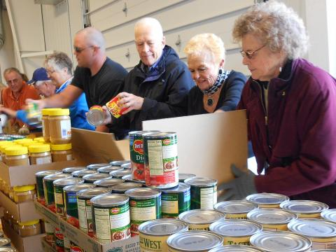 RSVP volunteers box food for low-income families